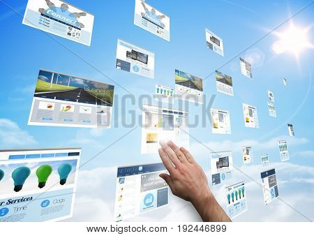 Digital composite of panels with websites(blue) in the sky. hand touching one of them