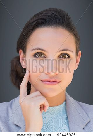 Digital composite of Close up of business woman thinking against grey background