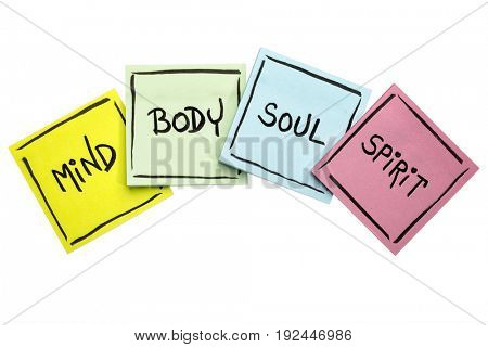 mind,  body, soul, and spirit concept - handwriting in black ink on isolated sticky notes