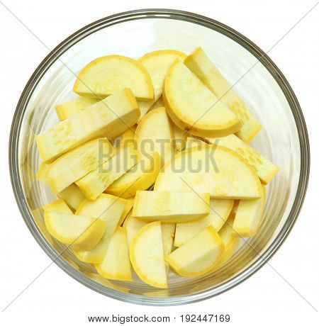 Chopped Unpeeled Yellow Summer Squash in glass bowl.