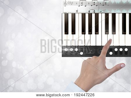 Digital composite of Hand Touching Piano keys with notes and effects App Interface