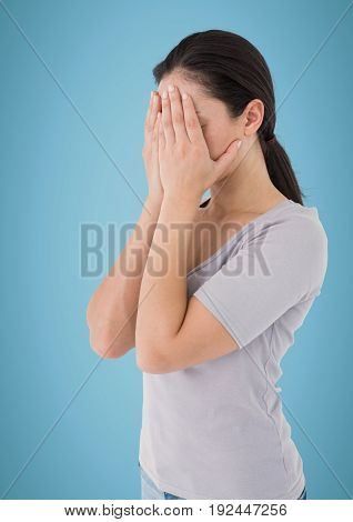 Digital composite of Woman hands on face against blue background