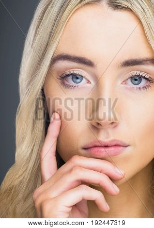 Digital composite of Close up of woman thinking against grey background