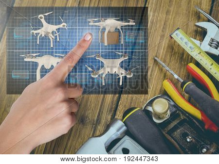 Digital composite of Hand pointing at a Drone DIY building App Interface