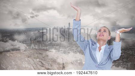 Digital composite of Tensed businesswoman gesturing against landscape