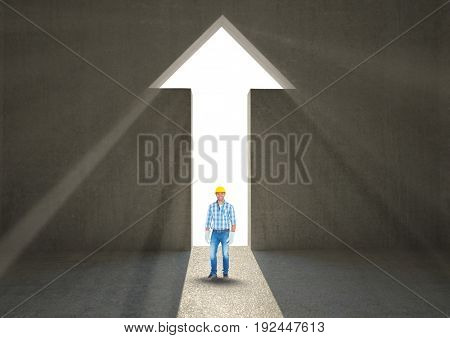 Digital composite of Male architect standing at arrow shape doorway