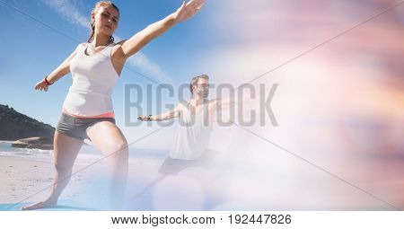 Digital composite of Fit man and woman exercising at beach