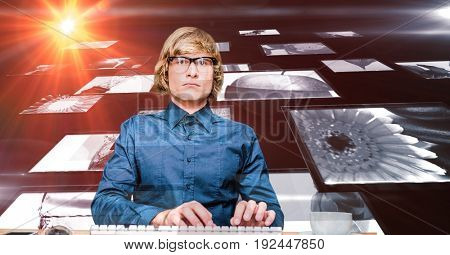 Digital composite of Digital composite image of hacker with screens
