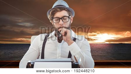 Digital composite of Male hipster with tobacco pipe looking at typewriter at beach during sunset