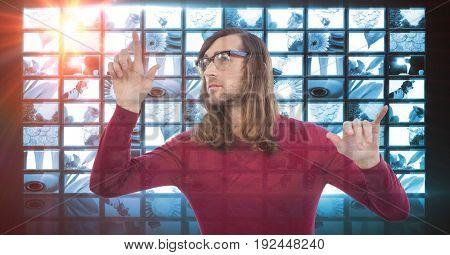 Digital composite of Male hacker touching screen
