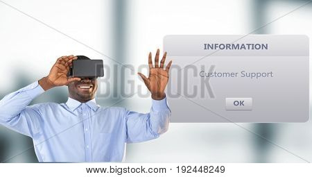 Digital composite of Smiling businessman using VR Glasses by dialog box in background