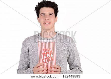 Portrait of young man eating popcorn. Isolated white background.