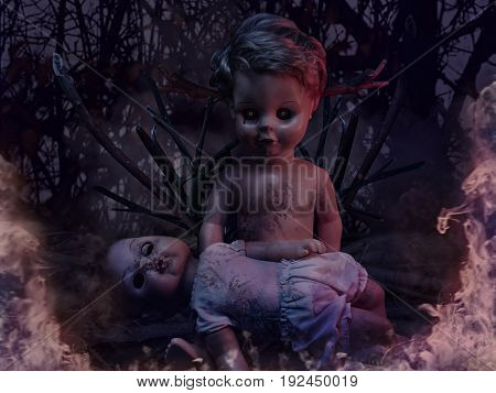 Two burning dirty creepy dolls sitting and lying on tree branches photo.
