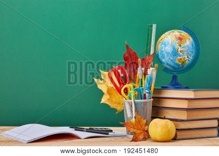 School background with stationery accessories.
