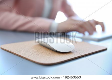 Pad with computer mouse and woman on background
