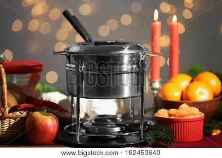 Fondue pot on festive table