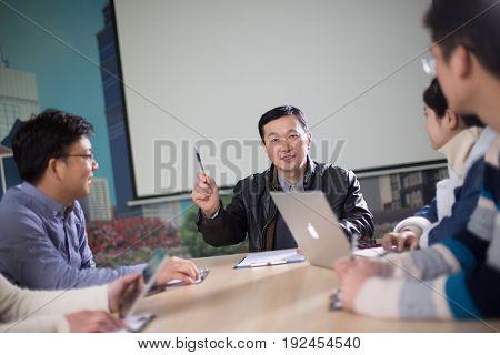 jinhua,china-Jan 23,2017:sales team discussing in meeting room