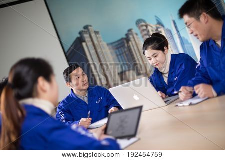 jinhua,china-Jan 23,2017:technician team discussing in meeting room
