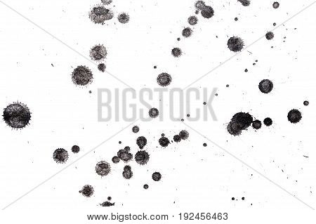 Abstract black ink splash. Ink blots. Elements of design. Water-soluble mascara on a white sheet of paper.