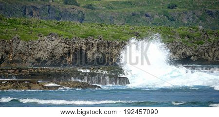 Huge waves and stone platforms Huge waves crash against beautiful stone platforms at a rocky shoreline in the tropical islands
