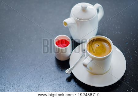 Cup of coffee on wooden table in coffee shop. Coffee break in morning selective focus