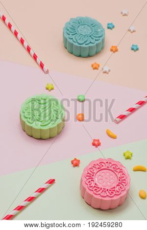 Table party setting. Traditional mid autumn festival colorful mooncakes.