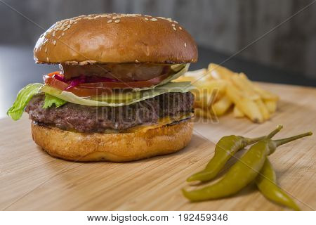 Fresh appetizing burger with green pepper, macro view