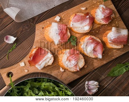 Table with bread and bacon