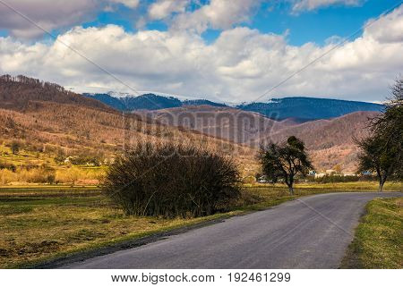 Countryside Road Through Valley To Village