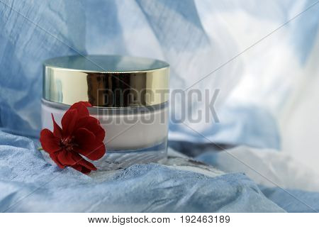 Jar with cosmetic cream on an empty background. It is possible to write free text
