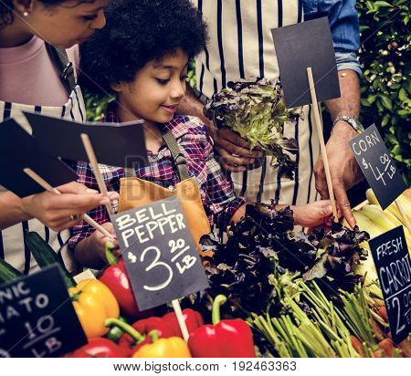 Little Boy Selling Vegetable at Market