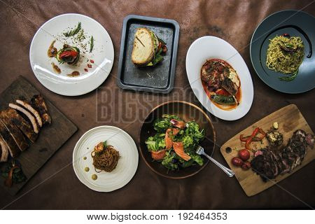 Mixed italian food plates on table