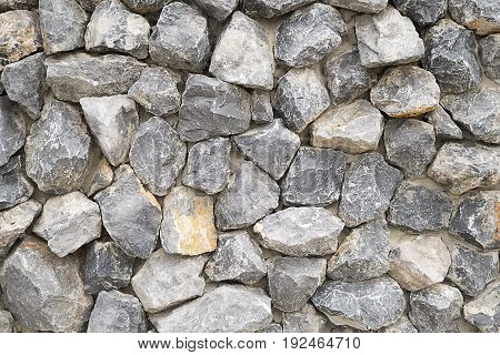 Pattern gray color of modern style design stacked stone wall background real stone wall surface with cement