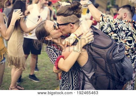 Woman Kissing Man in Live Music Concert Festival