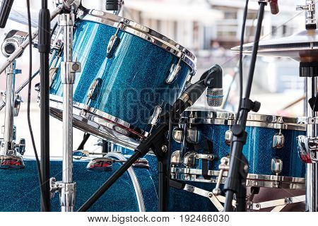 Modern Drum Set Standing In The Street Stage For Performance. Musical Instruments Closeup.