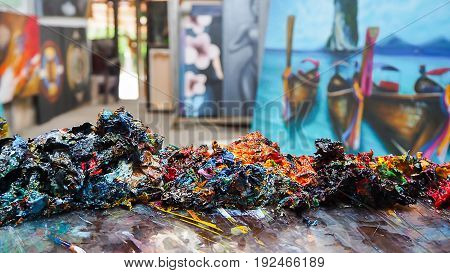 Art abstract colorful from oil painting in the gallery shop and blur oil painting picture in background