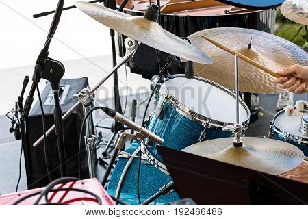 Street Musician Playing Drums With Drumsticks In His Hands