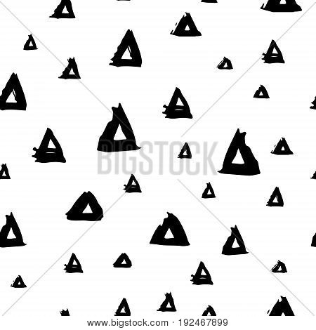Vector seamless pattern with brush triangles Black color on white background. Hand painted grange texture. Ink geometric elements. Fashion modern style. Endless fabric print. Retro