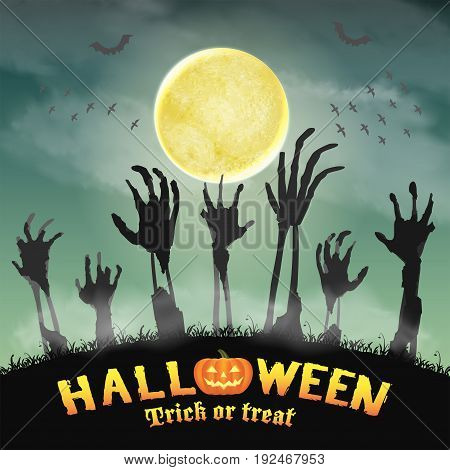 halloween zombie hand in a night graveyard