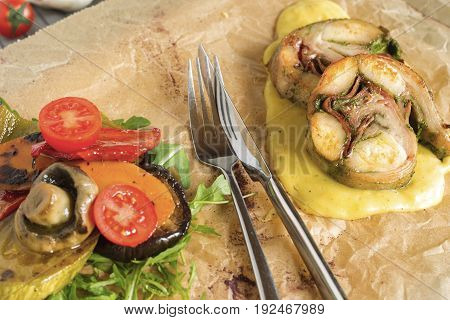 Roast rabbit meat with steamed vegetables and puree.