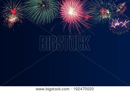 Fireworks on blue twilight background for new year celebration party festival or special occasions with copy space for text decoration