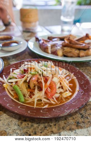 Som Tum famous Thai food spicy papaya salad