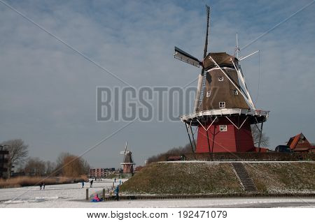 Classic Windmill in the City of Dokkum during the winter skating season.