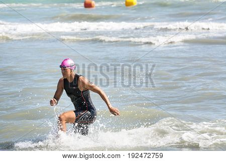 Pescara Italy - June 18 2017: Arrival of Huetthaler Lisa athletes at the end of the swimming test at Ironman 70.3 in Pescara