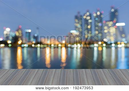 Opening wooden floor Office building blurred bokeh light at twilight abstract background