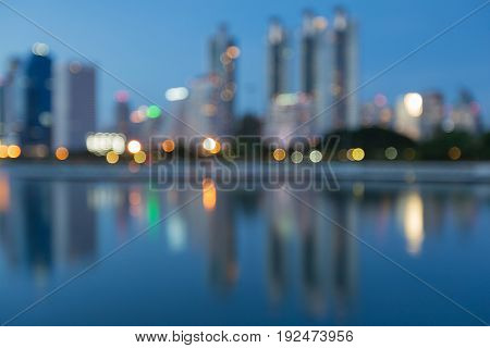 Reflection light city office building blurred bokeh at twilight abstract background
