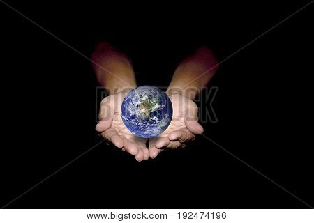 Blue earth in human hands isolated on black background. Elements of this image furnished by NASA.