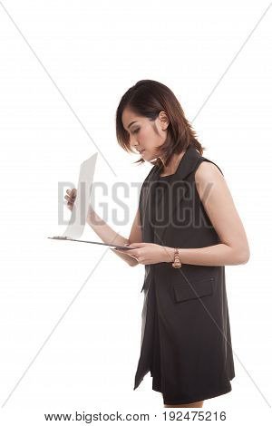 Young Asian Business Woman Read Paper On Clipboard.