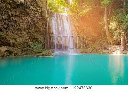 Blue stream natural waterfall in tropical deep forest natural landscape background