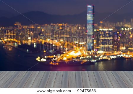 Opening wooden floor Night blurred bokeh Hong Kong city downtown abstact background